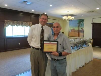 Greg presents Ed DeSousa with a plaque honoring his years of service to SVFT