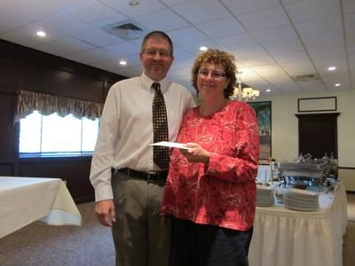 SVFT Vice President Greg Beyer honors Prince Tech's Pat Ripley for her service to the union